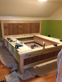 DIY bed with storage cubbies or drawers More