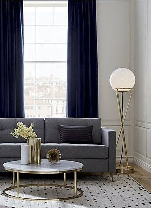 Into Thin Air White Globe Shade Hovers Atop A Minimalist Brass Base That Rises In Hourglass Form Floor Lamps Living Room Living Room Decor Modern Home Decor