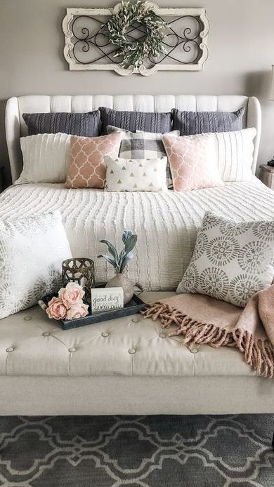 40 Beautiful Bedroom Decorating Ideas / Contrasting patterns in muted tones create a restful bedroom, while wall-mounted lights keep the bedside clear. Mix and match bedlinen in simple block-printed patterns and vintage stripes. White painted walls and floorboards allow the bed to take centre stage