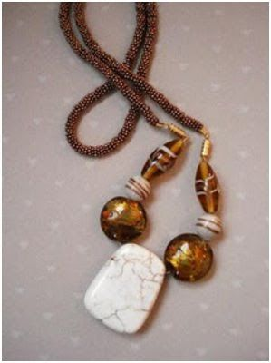 copper spacers were bought in bulk and came strung on a piece of wire. Lynda hadn't realized they were all individual beads so she used them as a group.