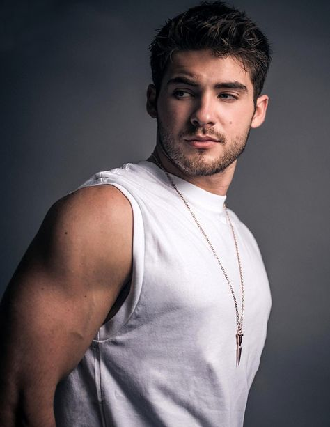 Cody Christian photographed by Arthur Galvao for Bello Mag. Cody wears Top x Karla, necklace IceLink
