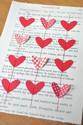 Using a page from a book, cut-out paper hearts, and sewing them down with contrasting thread - then framing.