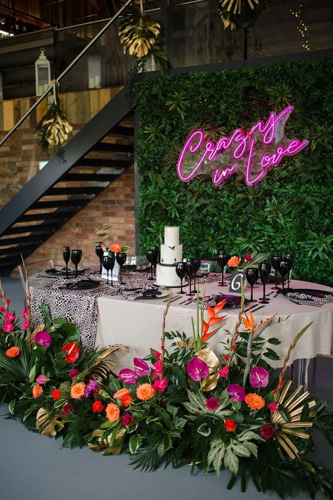 Tablescape Table Decor Pink Orange Tropical Flowers Palm Flower Wall Jungle Wedding Ideas Terri Pashley Photography #JungleWedding #LuxeWedding #Wedding #WeddingIdeas #ModernWedding #TropicalWedding #Tablescape #WeddingTable #WeddingDecor #PinkWedding #OrangeWedding #TropicalFlowers #Palm #FlowerWall