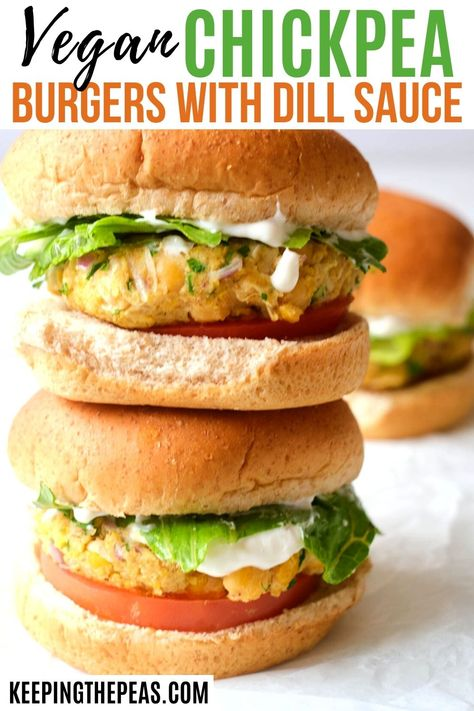 These easy to make chickpea patties have the flavors of the Mediterranean. Moist vegan chickpea burgers are seasoned with fresh parsley, and spices, served on top of a whole wheat bun, with crisp lettuce, juicy tomatoes, and a creamy vegan dill sauce!