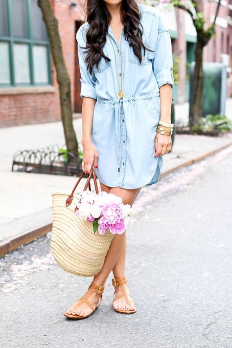 Chambray shirtdress Kat Tanita of With Love From Kat wears a spring outfit; denim chambray shirtdress, brown leather sandals and a straw basket in the West Village, NYC.
