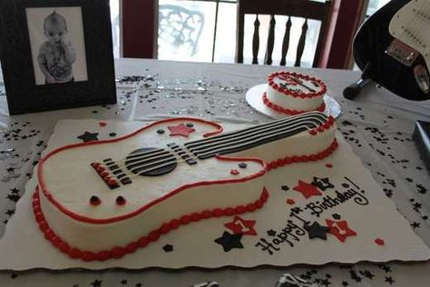 I like this guitar cake :) thinking it would do great for My Angel Boys birthday!!!
