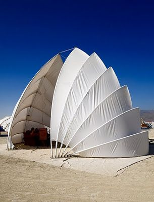"""the chiton"", a shell-like collapsible structure at burning man. designed by d'milo hallerberg"