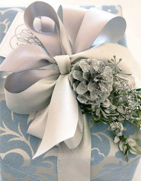 silver damask fabric wrapping with silver satin bow and glittered silvered pine cone and greens via Hadley Court - Holiday Wrapping Ideas - Lynda Quintero-Davids (4)
