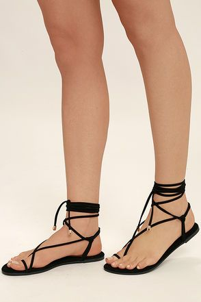 The Lulus Micah Black Lace-Up Flat Sandals have us dreaming of tropical climates! From a toe loop upper, slender vegan leather straps (with gold aglets) cross and lace-up above the ankle.