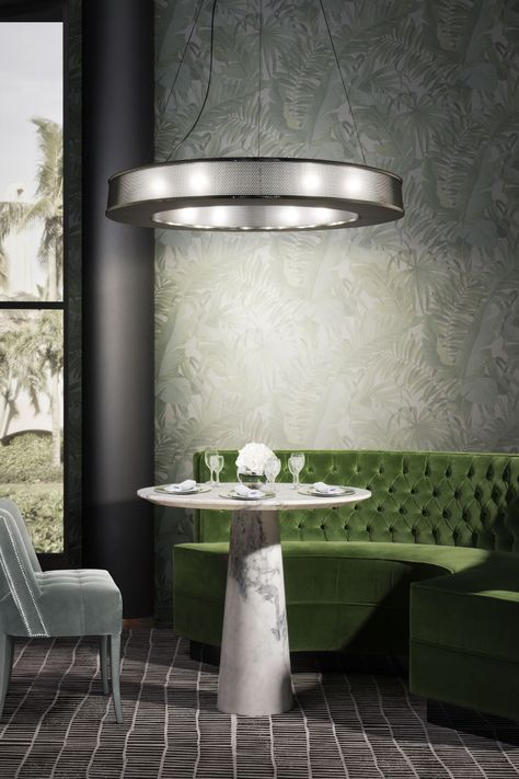 An exotic decoration in green and silver that can easily fit in any restaurant. Visit insplosion.com and get inspired for your next restaurant project!  #inspirational #interiordesign #interiordesigninspiration #restaurantinspiration #restaurantinteriordesign #luxuryrestaurant