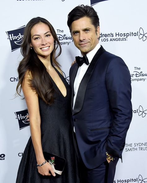 Actors John Stamos and Caitlin McHugh arrive at the 2018 From Paris With Love Children's Hospital Los Angeles Gala at L.A. Live Event Deck.