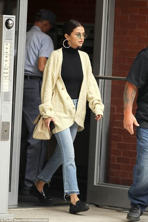 Sweater weather: Selena looked cozy in her warm-hued ensemble as she grabbed a bite to eat.