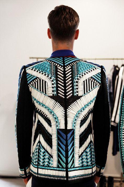 Backstage – Beaded jacket in geometric tribal pattern. Backstage at Balmain Spring Menswear. Photo: Marie-Amélie Tondu www. Highlight Description Beaded jacket in geometric tribal.