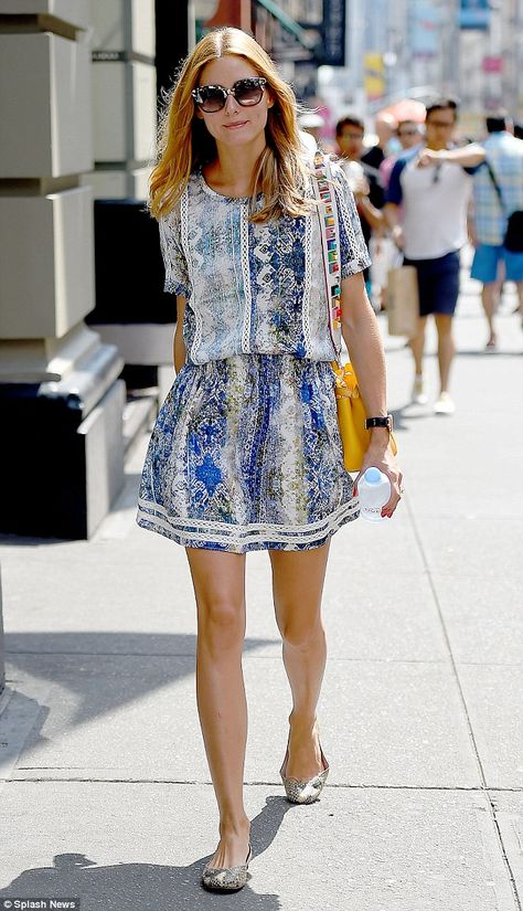Pop of color: The former Elle intern added a bright yellow handbag for her summer look