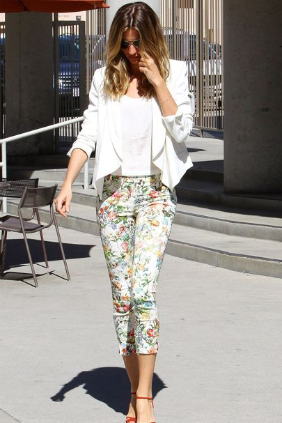 LA - March 9 2014 Gisele Bündchen wore floral trousers and a white jacket for the baptism of her daughter, Vivian.
