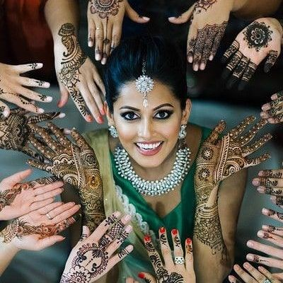 Bride with her friends celebrating her mehendi ceremony and