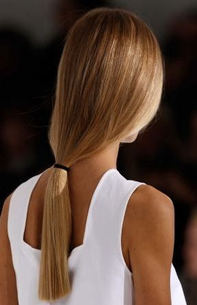 The Simplest Of Hairstyles Loose Low Pony Tail On Straight Shiny Hair Tied With A Plain Black Band Tanned Skin And White To Hair Styles Hair Long Hair Styles