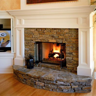 Traditional Fireplace With Raised Hearth Design & Wood Mantel w/legs. And I like how there's a place for the tv that is angled just right.