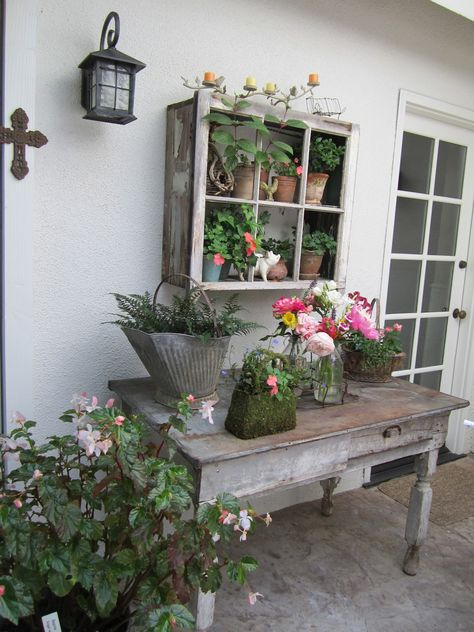 Pretty window storage idea for a potting shed or vertical gardens on the porches to hold orchids ferns etc