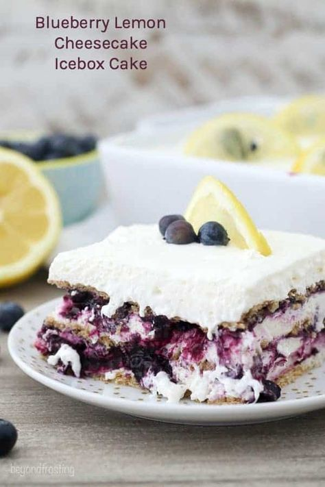This Blueberry Lemon Cheesecake Icebox Cake is layers of honey graham crackers, a sweet blueberry sauce and a tangy lemon cheesecake. This no-bake dessert is the perfect for summer, and the homemade blueberry sauce is amazing! #iceboxcake #dessertlasagna #nobake #nobakedessert #blueberry #lemon #blueberrylemon