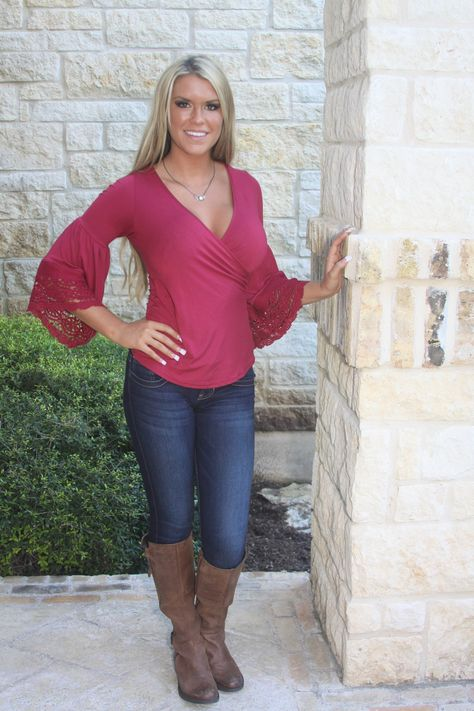 The Venetia Bell Sleeve top is a fitted wrap style done in a muted burgundy with beautiful lace trimmed bell sleeves. Great color for the holidays ahead! 95% Vicose, 5% Spandex. Designer Va Va by Joy Han. Made in the U.S.A.