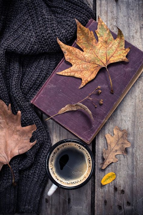 Old book, knitted sweater with autumn leaves and coffee mug by Fancy Things on @creativemarket