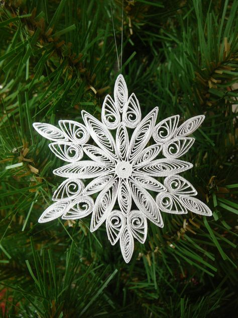 $5.95 each (Please select how many you would like) These Handmade Paper Quilled Snowflakes are approximately 3 1/4 in diameter & 1/8 thick. Use as a Gift Toppers, Ornaments, on cards, hang them on your rear view mirror in your vehicle or give them away as Party Favors for Frozen