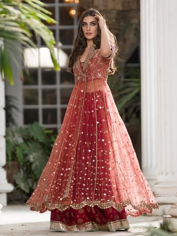 Crafted from tulle and paired with a lehenga, this timeless angrakha style engagement dress will take you through years of evening engagements in style.