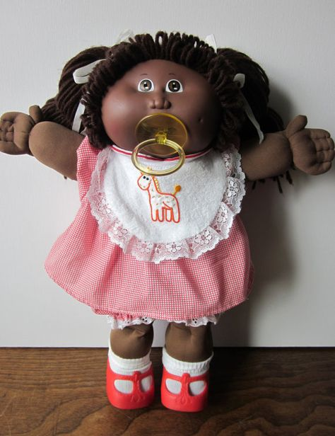 Vintage Cabbage Patch Kid Doll My first doll was black and I named her Cherrie from Punky Brewster. My doll had dark blue overalls, a white laced top and her hair in pigtails. I wish I could find her again. My first best friend.