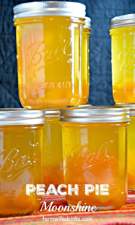 Peach Pie Moonshine - The Farmwife Drinks Peach Pie Moonshine, the perfect mason jar gift for the most important people in your life who need who need a stiff drink. Mason Jar Drinks, Liquor Drinks, Whiskey Drinks, Mason Jar Gifts, Alcoholic Drinks, Liquor Mixers, Scotch Whiskey, Irish Whiskey, Peach Pie Moonshine