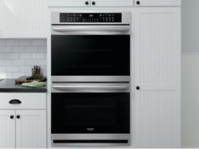 Stainless Steel Double Wall Ovens In A Kitchen With Images
