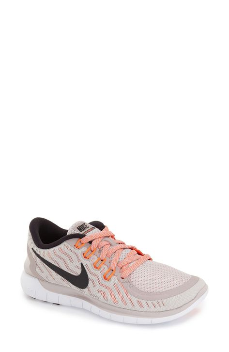 timeless design 1e4e5 f3098 Crushing on these Nike Free running shoes with orange details for a fun pop  to the active gear.