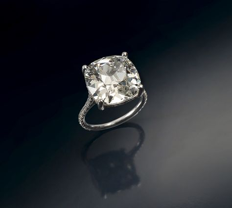 A Spectacular Diamond Ring.  Cushion cut diamond weighing 10.19 cts, set in platinum pave set with brilliant cut diamonds. Accompanied with HRD Report no: 08024193001 stating that the diamond is I VS2  Tzoffey's 1818