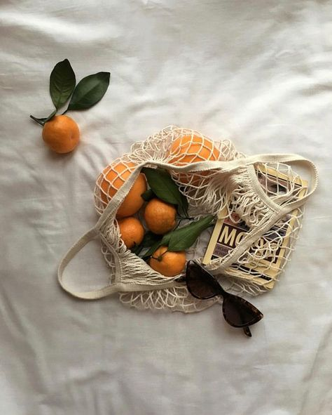 minimal & simple instagram flat lay photography inspiration | oranges in mesh bag