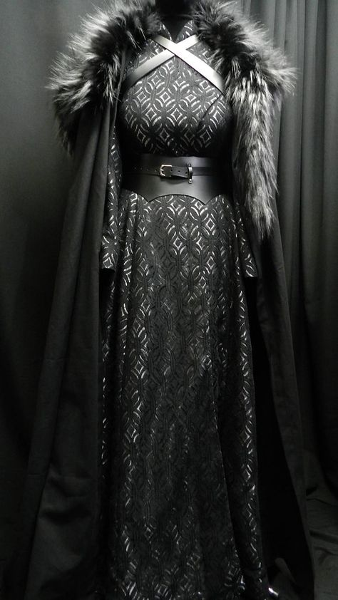 Game Of Thrones Inspired by Sansa Stark black silver dress, leather belt, cloak and shoulder's fur custom made to your size!- Game Of Thrones Inspired by Sansa Stark black silver dress Game Of Thrones Outfits, Game Of Thrones Dress, Game Of Thrones Clothing, Game Of Thrones Cosplay, Black And Silver Dress, Black Silver, Black Satin, Black Belt, Black Laces