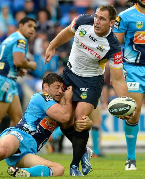 Scott Bolton of the Cowboys offloads during the round 12 NRL match between the Gold Coast Titans and the North Queensland Cowboys at Skilled Park on June 2013 in Gold Coast, Australia.