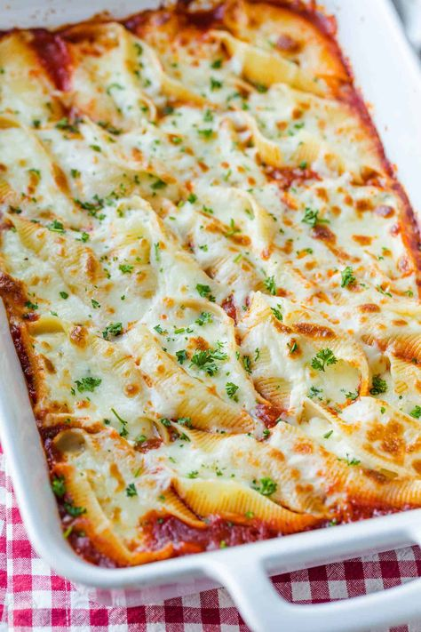Stuffed Shells filled with ricotta, parmesan, and melty mozzarella cheese. Stuffed Pasta Shells always disappear fast and reheat well.