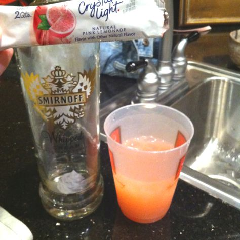 Cotton Candy Drink! Amazing! Low calorie! Simply mix Smirnoff Whipped Cream Vodka with Crystal Light Pink Lemonade and there you have it: a Cotton Candy flavored low cal drink that's tasty and PINK!