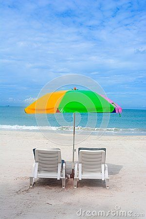 Colorful Umbrella With Two Relaxing Chairs In Beach Background Beach Background Beach Chair Umbrella Relaxing Chair