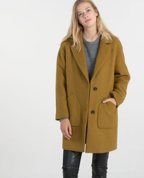 Porter manteau beige homme