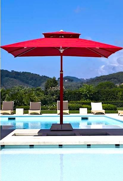 Dynamic Sleek And Luxurious Poggesi Is The Ultimate Addition To Any Patio Our Umbrellas Are Both Beautiful And Versatile Wit Patio Poolside Decor Backyard