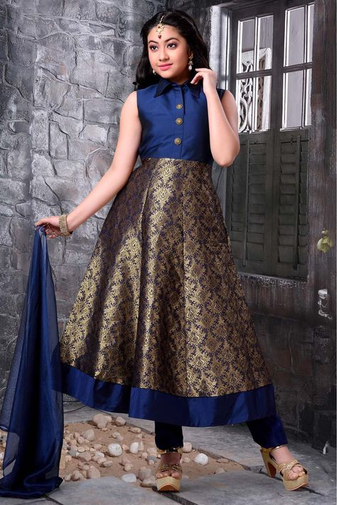 Dress up your little diva in a plush Banarasi,Jacquard,Taffeta,Silk suit.The bright Blue colour of the Anarkali Suit looks charming and pretty. This Anarkali Suit will make your dear little angel look...