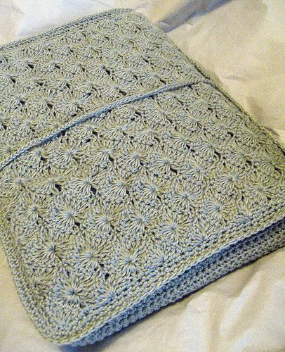 I have to make one of these - its a laptop cover. Theres actually something very similar to this in the Lacy Crochet book, but its for a needle case. Love the colour of this too.