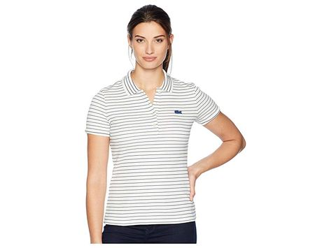 864e40ae Lacoste Short Sleeve Slim Fit Stretch Striped Polo (Flour/Inkwell) Women's  Clothing. Lacoste Sport fuses comfort with sporty style in this Slim Fit  Striped ...