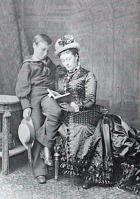 In this image. Princess Alice reads to her son Ernest. successor to the title of Gran…   Princess alice. Queen victoria family. Queen victoria ...