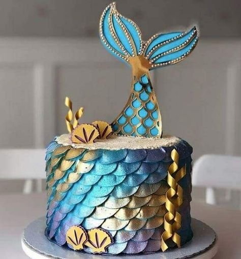Metallic mermaid tail cake. Beautiful blue and yellow colors.