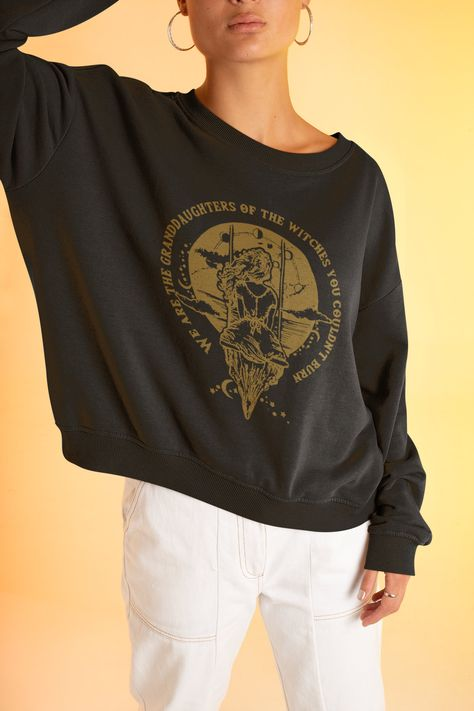 """""""Hi There! Thanks for checking us out! This awesome We Are the Granddaughters of the Witches You Could Not Burn design is screen printed on unisex crew from Gildan for that perfect oversized look and will have people asking you, \""""Where did you get that?\"""" This soft sweatshirt has a loose fit for a comfortable feel. With durable print, it will be a walking billboard for years to come. .: Loose fit .: 50% Cotton; 50% Polyester (fibre content may vary for different colors) .: Medium fabric (8.0 oz"""