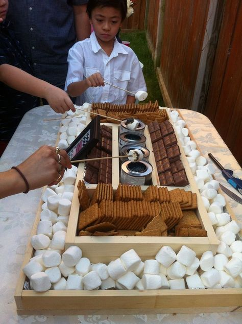 smores bar setup   DIY s'mores bar. Perfect for an outdoor party.but with a real for instead of gas fire