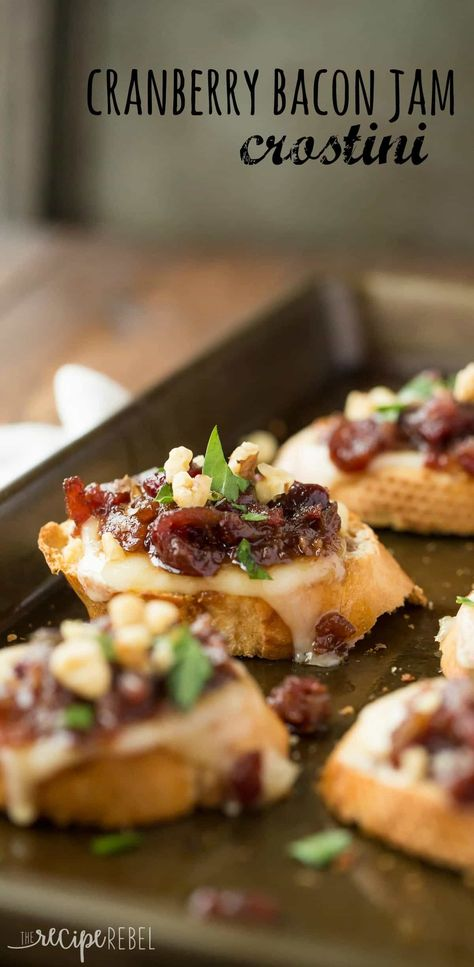 Easy, make ahead Cranberry Bacon Jam and cheese on top of a crusty baguette, topped with chopped walnuts for extra crunch -- these crostini are the perfect combination of sweet, smoky, salty and cheesy! #thanksgiving #food #recipes #thanksgivingrecipes #appetizers #thanskgivingappetizers
