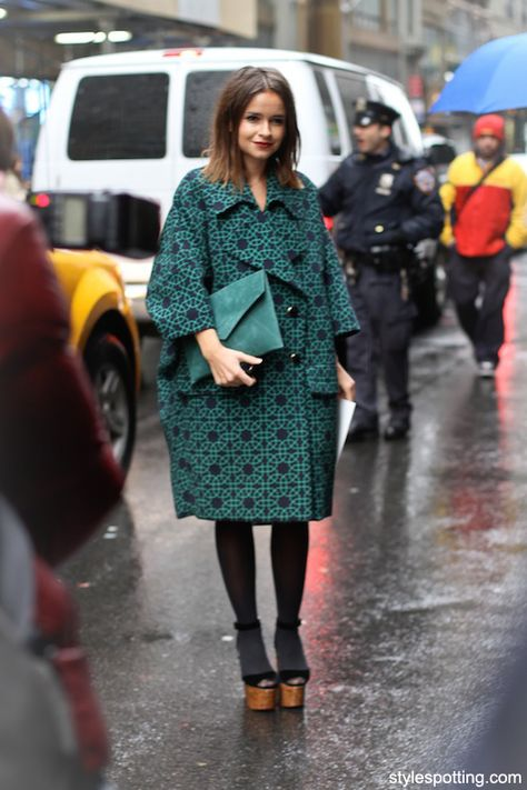 Miroslava at #nyfw wearing an oversized coat and clutch without drowning her teeny tiny frame. how does she do it?